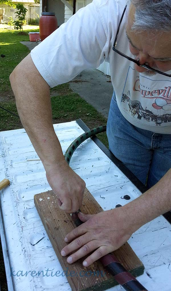 Trim the drilling debris away from the hole.