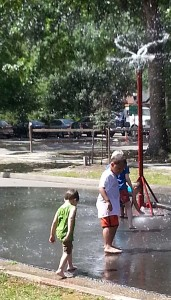 The fire department turned on a sprinkler so children could play in the water.