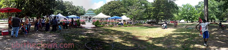 Hoops, balloons, vendors, and farmers' market at Art in the Park, Herman Park, Goldsboro, NC. Looking toward the fountain.