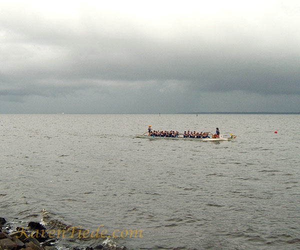 One of the dragon boats moving on the river.