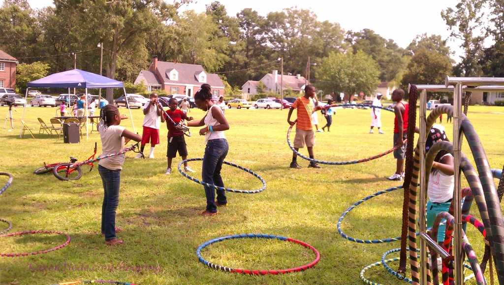 The children in the big hoop are about to figure out it won't hoop two people that way.