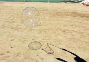 Giant bubbles cast shadows.