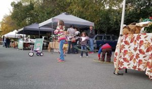 Vendors' children took the baby hoops out for a spin.