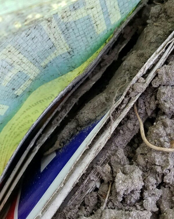 Close up of signs and dirt in a dog food bag.